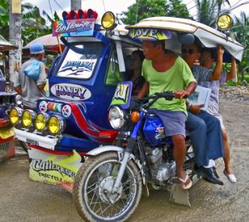 tricycle - public transportation, motorcycle with side cabin for passengers.