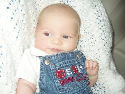 Jake Daniel at 6 weeks - this is him in his favorit awing, being as cute as ever :)