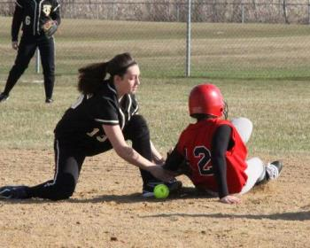 Girls Softball Game - In this photo you see the ball is clearly on the ground and the runner should be safe but what the umpire saw was the fielder with the ball when she started to make the tag but did not see the ball fallout. I was able to capture that right moment. To me this is a great photo but to others it is a good shot because they don't study the photo to see the details.