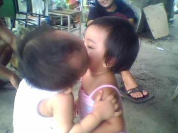 their first kiss  - my nephew kissing his playmate in 2009