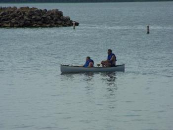 At the lake. - Hubby and I out on the lake in our canoe.