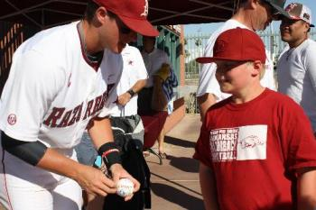 Carson getting autographs - Carson was able to get autographs from the Arkansas players