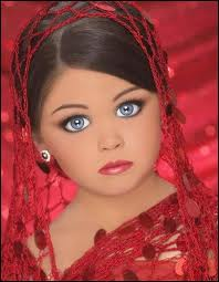 Child in beauty pageant - Another example of forced precociousness in children.
