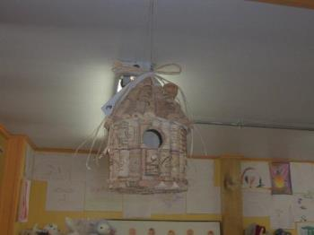 Bird house out of corks - she saw it in a restaurant...
