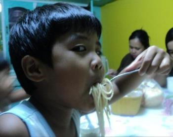 Pasta lover - Enjoying his food a lot!