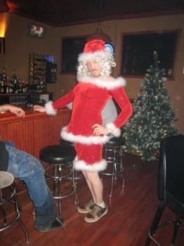 Mrs. Santa Claus ??? - My youngest son dressed as Mrs. Santa Claus one year near Christmas. He worked there in that bar where the photo was taken. His friends all said that, if they had been having a costume contest, he would have won, hands down! LOL