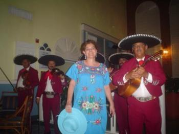 Mariachis and mexican dress - A friend of mine took this picture of me while singing rancheras with the mariachis.