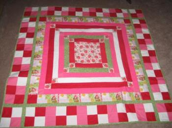 Strawberry Shortcake QUilt - I made this one...limited on the SS pattern fabric I couldn't find it! So I just made this the center square and worked my way outward with matching color sashing