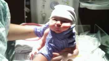 Keely - This is keely moments after she was born. She was so calm. And those eyes...wide open. She amazes me.