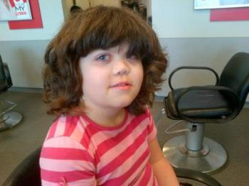 my daughter's hair just before her haircut - She has such a huge head of hair it took about 20 mins for a professional hair cut.