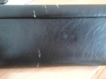 My clutch bag - The damage on my clutch bag.