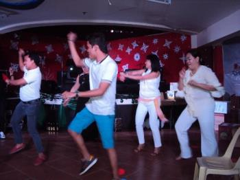 Dancing the Gangnam - Here i am dancing the Gangnam as requested by my boss! I'm the one in whole white with an orange sash.
