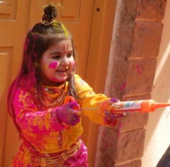 holi haiy - a girl throwing colored water