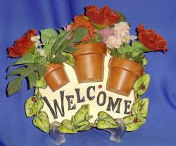 Welcome - Welcome flower pot sign.
