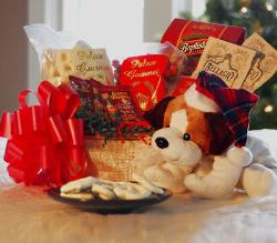 "christmas gift collection - This cute and cuddly puppy is all dressed up for the holidays and ready to delight your friends and family. He comes in a 10"" oval wicker basket overflowing with holiday treats. Included in this gift are three Celestial Seasonings teas, two Bellagio white cocoas, Palace Gourmet peanut delite mix, mozzarella cheese swirls, Palace Gourmet white yogurt pretzels and Palace Gourmet white Jordan almonds. This gift is truly a treat for someone you care about this holiday season."