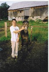 My son and his horse Kharouf - This is my son on his cousin's farm with his horse Kharouf, a pure blooded Arabian mare.
