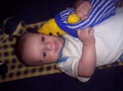 Kai, my beautiful son... - Heres a pic of my beautiful five month old baby boy Kai and his favoutite toy in the world a knitted Bananas in Pyjamas doll that his Nana, my mum, gave him. He adores it and is always bashing it up which is why we have aptly nicknamed it Bam Bam...LOL