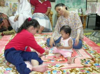 together at home - My baby, cousin and her auntie during our barbeque party.