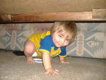 My baby - My Son playing under the coffee table