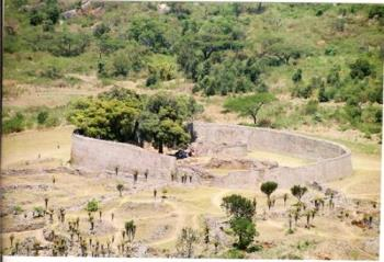 """Great Zimbabwe - GREAT ZIMBABWE  The ruined city of Great Zimbabwe, near Masvingo, is the largest and most significant ancient monument south of the Sahara. The towering """"stone houses"""" (dzimba dzembabwe) are the remains of a city of 20 000 shona- speaking people which prospered between the 12th and 15th centuries. The grand concept is an eloquent testament to the advanced culture of its African builders.  A beautiful stylised soapstone fish eagle now the national emblem, was found in the ruins. The sculpture has pride of place in the site museum. The whole complex extends across 270 hectares and a whole day visit is strongly recommended.  Great Zimbabwe  On top of the hill, a dry stone citadel set among giant boulders overlooks the valley. It is a breathtaking view. Down below is an enclosure 250m in diameter with double walls up to 100m high, a great conical tower, smaller towers and many lesser enclosures linked to sunken passageways and walls. Everything has been constructed entirely without mortar – a million stones, each one balancing on each other.  Nearby Lake Mutirikwi is a popular water sports resort, with excursions to bird Rich Island and pony trekking in the game reserve on the north shore. Visit nearby traditional villages where the true Zimbabwean hospitality awaits you. This is an experience you should never miss."""