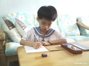 Doing Homework - My nephew doing his kindergarten homework using pencil not computer ;-)