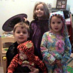 My kids in their costumes - This was Thursday before we went trick or treating.  They were Tigger, Batman, a witch and a clown.  I made all the costumes except the Tigger one, which we bought for our oldest in 2001.  They have all worn the Tigger costume for their first trick or treat event.