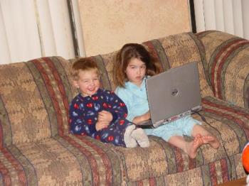 children - my daughter and son playing on there dad laptop