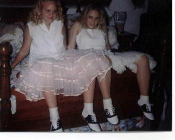 The best year of my life - This is me at 19 with my best friend Amber.  She has the pink Crinoline I have white.  We had just come from a sock hop and we were being goofy.