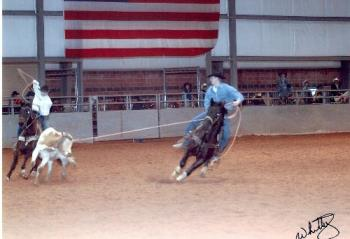 Nephew in Rodeo in TX - My nephew and his cousin in a calf roping contest at a rodeo in Texas. They did good that day.