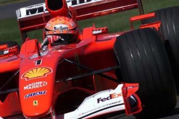 Formula I - Schumacher - Despite Ferrari's dominance, Kimi Räikkönen driving for McLaren-Mercedes had a chance of claiming the championship in 2003 right until the end of the season at the Japanese Grand Prix. Juan Pablo Montoya driving for Williams-BMW also came close. Also in 2003, Fernando Alonso became the youngest ever pole sitter by qualifying first at Malaysia. Later that year he became the youngest ever winner of a Grand Prix when he took the chequered flag in Hungary. Schumacher's championship streak finally came to an end on September 25, 2005 when Alonso clinched the 2005 championship with a third place finish at the Brazilian Grand Prix to become the youngest champion to date, replacing previous record holder Emerson Fittipaldi of Brazil. Michael Schumacher had been world champion for more than 1,800 days.