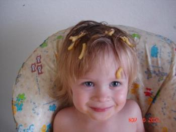 macaroni pic number two - my daughter proud of her acomplishment of a hat of macaroni. This is not the same picture on my profile.