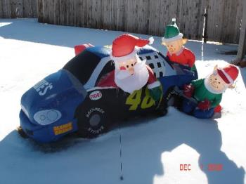 santa and elves 48 car in snow - This is our inflatable jimmie Johnson car in the snow we had.