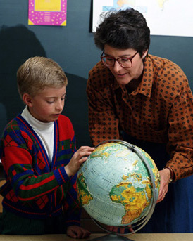 A Child with ADHD - This is a photo of a boy with ADHD being taught geography by a teacher. He needs special education.