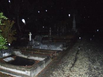 Spirit orbs? - Photo taken at a cemetery at night with aparent orbs in them