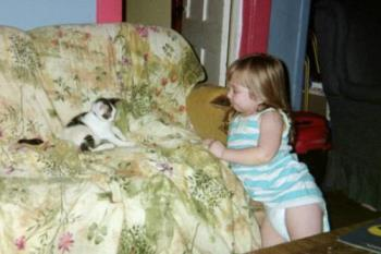 My daughter and my kitten Alexis - they are so cute.