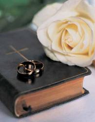 Marriage - A symbol of the Marriage Ceremony - Bible, Ring, and flower
