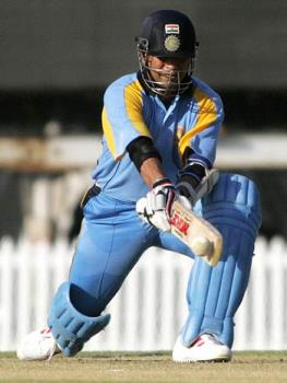 master playing a class shot... - Sachin playing a reverse sweep....