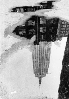 Puddle, Empire State Bldg  - a photo taken by Andre Kertesz in 1967. American photographer born in the Austro-Hungarian Empire