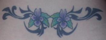 my lower back tattoo - A picture of the tattoo on my lower back