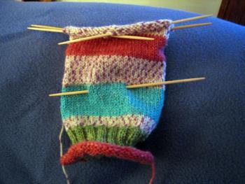 Knitted Sock in progress - .JPG image of a knitted sock in progress, using double pointed needles and self-striping sock yarn.