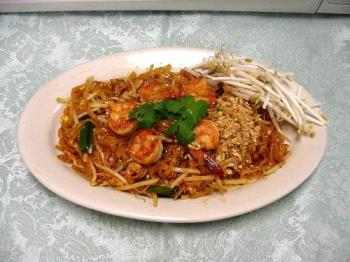 """Noodles - Chow mein is a stir-fried dish in American Chinese cuisine, consisting of noodles, meat, and cabbage and other vegetables. The pronunciation of """"mein"""" is Cantonese and the pronunciation of """"mian"""" is Mandarin. It is often served as a specific dish at westernised Chinese restaurants with soy sauce and vegetables such as celery, bamboo shoots, and water chestnuts."""