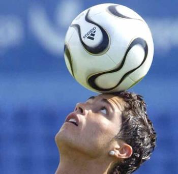 Ronaldo - Ronaldo Balncing th ball on his head.