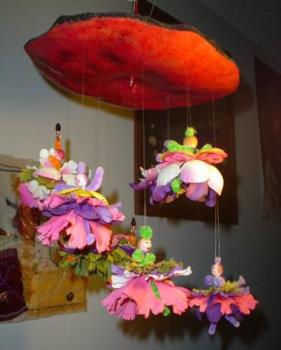 Gourd mobile Dancing Girls - The top is a slice of gourd. Each doll has a wooden bead for a head and a pipe cleaner body and flower petal skirts.