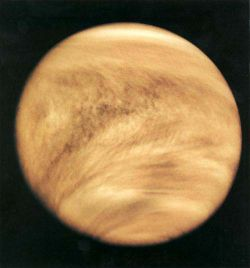 Venus - Venus (0.7 AU) is of comparable mass to the Earth (0.815 Earth masses), and, like Earth, possesses a thick silicate mantle around an iron core, as well as a substantial atmosphere and evidence of internal geological activity, such as volcanoes. However, it is much drier than Earth and its atmosphere is 90 times as dense. Venus has no natural satellite. It is the hottest planet, with surface temperatures over 400 °C, most likely due to the amount of greenhouse gases in the atmosphere. Although no definitive evidence of current geological activity has yet been detected on Venus, its substantial atmosphere and lack of a magnetic field to protect it from depletion by the solar wind suggest that it must be regularly replenished by volcanic eruptions.