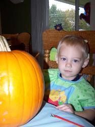 Painting pumpkins - This is my little guy painting his pumpkin.
