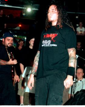 """P.O.D. - While they play around with the infectious grooves of reggae and Latin music as well as the heavy deliverance of hip-hop and rock, San Diego's hard rock four-piece P.O.D. has defined a universal message. They're born-again Christians and their faith takes a central place in their music.Formed in 1992 in the SoCal neighborhood of San Ysidro, Marcos (guitar) and Wuv (drums) relished the music they grew up on. San Ysidro or """"Southtown"""" was a multicultural area, but working class. While Marcos and Wuv were fond of their jazz and reggae roots, they were young punks in the making. Both loved the gnarl of grunge and took to liking Green Day, Pennywise, Bad Brains, and the Vandals. They got a band together, P.O.D. (short for """"Payable on Death""""), with Wuv's hip-hop MC cousin, Sonny, and aimed for something real. Cleveland native Traa joined in 1993 and P.O.D. were on the map.Throughout the 1990s, P.O.D. played countless shows across the nation and sold more than 40,000 copies of their three homemade EPs -- Brown, Snuff the Punk, and P.O.D. Live -- on their own Rescue Records. Atlantic Records was intrigued by the group's hard-working ethic and passion for music, inking a deal with P.O.D. in 1998. The Warriors EP preceded the major-label debut of P.O.D.'s 1999 release, The Fundamental Elements of Southtown. """"Southtown"""" and """"Rock the Party (Off the Hook)"""" were powerful singles, pushing the album to go platinum. P.O.D. earned top honors for Best Hard Rock or Metal Group, Album of the Year, and Song of the Year for """"Rock the Party (Off the Hook)"""" at the 1999 San Diego Music Awards as well.A year later and with the buzz still going, P.O.D. hit the road with Ozzfest 2000 and shared dates with Crazy Town and Staind for the MTV Campus Invasion tour. They also ventured into films, contributing several songs to various soundtracks. """"School of Hard Knocks"""" proved successful in the Adam Sandler comedy Little Nicky in 2001, whereas additional tracks featured in the Al Pacino spo"""