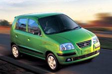 santro car - a green santro car