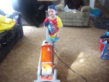 Skylar sweeping - this is one of my fav pics..in tye dye,bandana..and loving the sweeping lol..