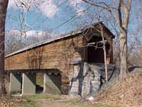 Meems Bottom Covered Bridge VA - Today, Meems Bottom Bridge is the last remaining covered bridge in Virginia maintained by the Department of Transportation for public use as a throughway.  The bridge has over a 200-foot single span Burr arch truss, which makes it the longest covered bridge still standing in Virginia.