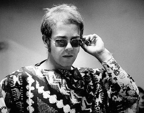 Elton John wearing glasses - His trademark are his glasses.